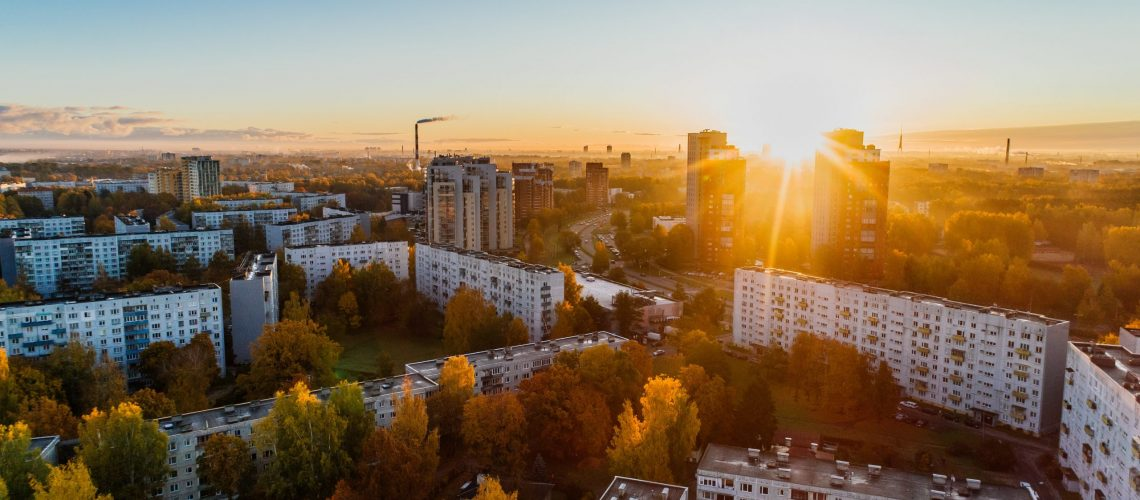aerial-view-of-white-concrete-buildings-during-golden-hours-681368